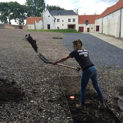 shovelling dirt in the courtyard trench