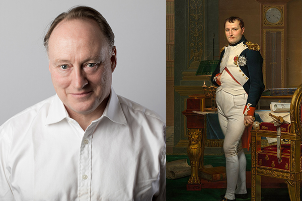 Historian and journalist Andrew Roberts alongside a painting of Napoleon.