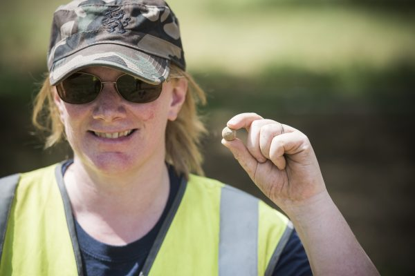 A Waterloo Uncovered participant with a smaller find