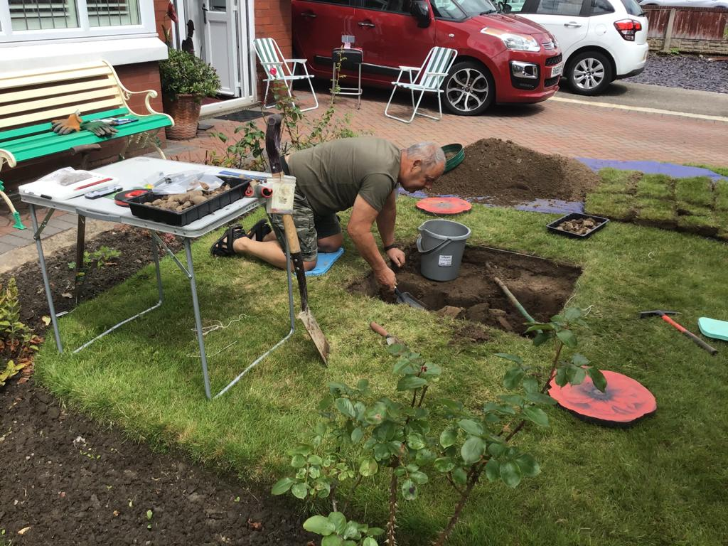 One of the virtual programme participants digging a one metre by one metre test pit in his front garden.
