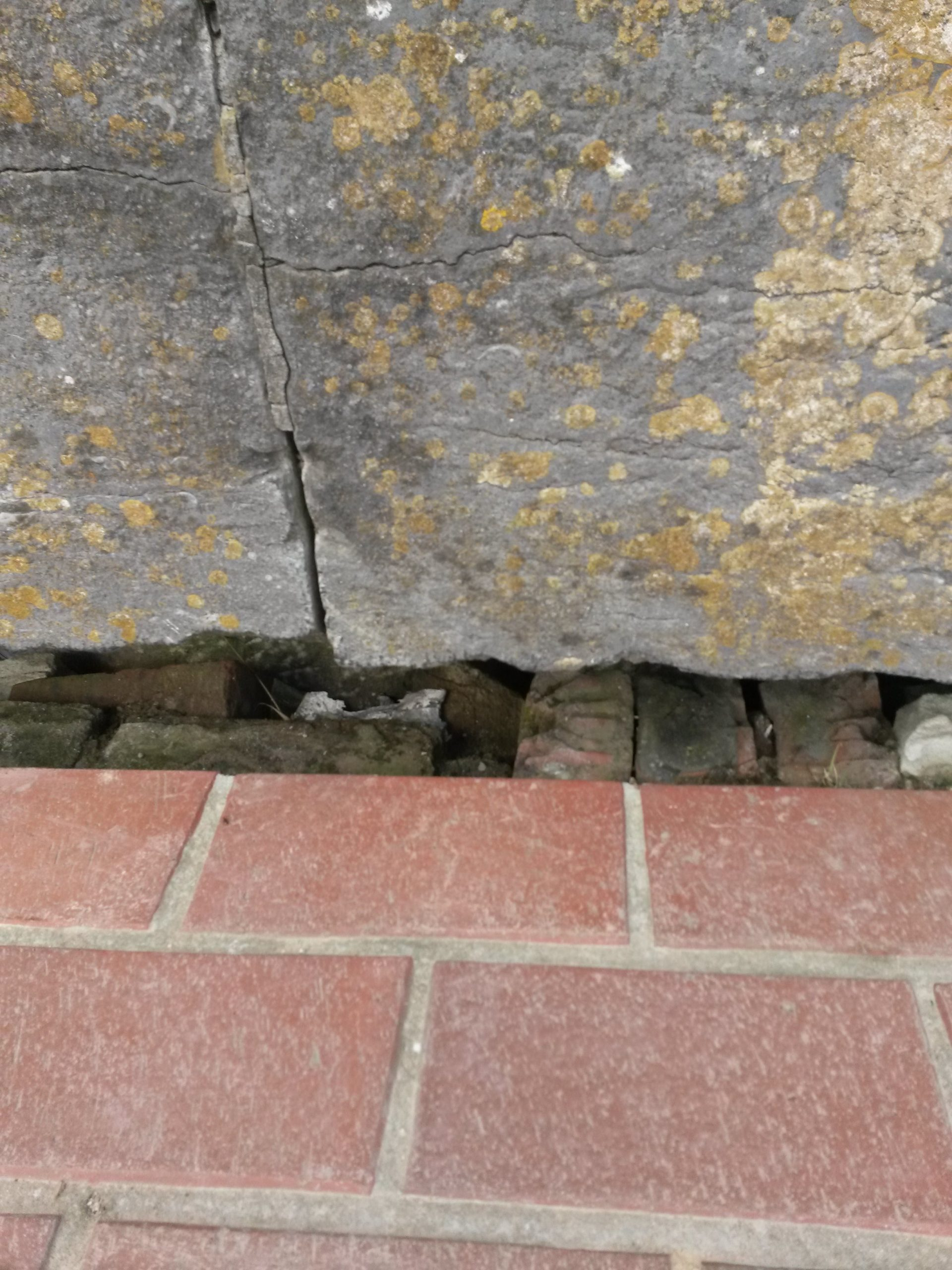 A close up of the brick column at the base of the lion on the Lion's Mound