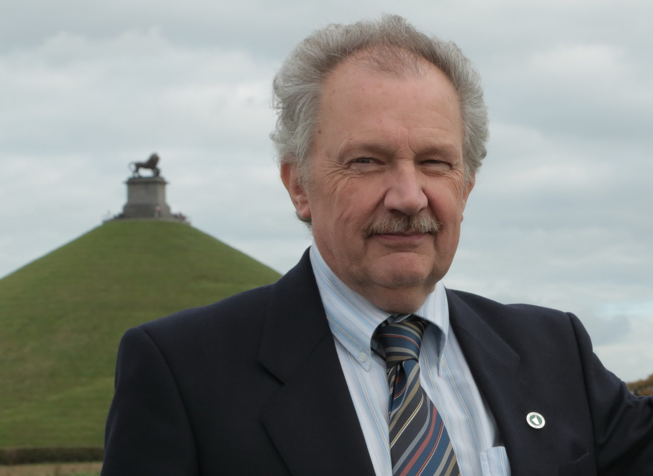 An image of Alain Lacroix next to the Lion's Mound