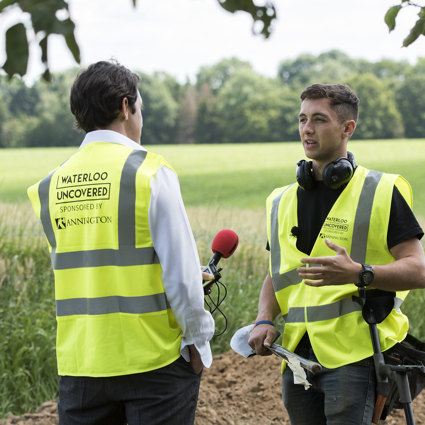 A serving soldier being interviewed for the BBC while wearing an Annington branded high vis.